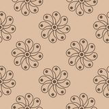 Brown floral ornament on beige background. Seamless pattern. Brown floral design on beige background. Seamless pattern for textile and wallpapers Stock Photos