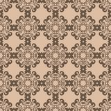 Brown floral ornament on beige background. Seamless pattern. Brown floral design on beige background. Seamless pattern for textile and wallpapers Stock Image