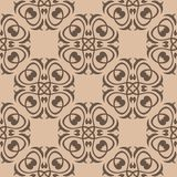 Brown floral seamless pattern on beige background. Brown floral ornament on beige background. Seamless pattern for textile and wallpapers Stock Image