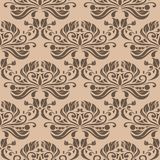 Brown floral seamless pattern on beige background. Brown floral ornament on beige background. Seamless pattern for textile and wallpapers Stock Photos