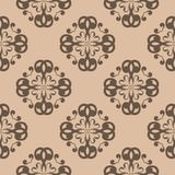 Brown floral seamless pattern on beige background. Brown floral ornament on beige background. Seamless pattern for textile and wallpapers Stock Photo