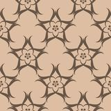Brown floral seamless pattern on beige background. Brown floral ornament on beige background. Seamless pattern for textile and wallpapers Royalty Free Stock Photos