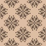 Brown floral seamless pattern on beige background Stock Images