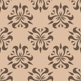 Brown floral seamless pattern on beige background Stock Image