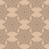 Brown floral seamless pattern on beige background. Brown floral ornament on beige background. Seamless pattern for textile and wallpapers Royalty Free Stock Images