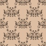 Brown floral seamless pattern on beige background. Brown floral ornament on beige background. Seamless pattern for textile and wallpapers Royalty Free Stock Photo