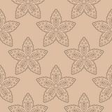 Brown floral seamless pattern on beige background. Brown floral ornament on beige background. Seamless pattern for textile and wallpapers Royalty Free Stock Image