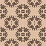 Brown floral seamless pattern on beige background. Brown floral ornament on beige background. Seamless pattern for textile and wallpapers Stock Photography