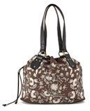 Brown Floral Women's Handbag. A floral printed brown women's handbag with black handles Stock Image
