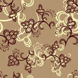 Brown Flower Pattern. Dark brown and beige flowers on a brown background Royalty Free Stock Images