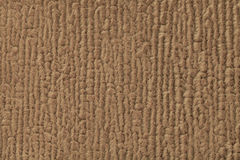 Brown fluffy background of soft, fleecy cloth. Texture of textile closeup Stock Photos