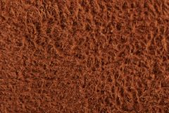 Brown fluffy wool texture. Background clsoe up view royalty free stock photography