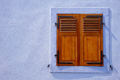 Brown folding shutter of a violet home Royalty Free Stock Image
