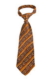 Brown Formal Tie On White. Brown Formal Tie With Striped Pattern Isolated on White Stock Photo