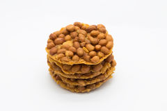 Brown fried peanut cracker on white. Background Stock Photo