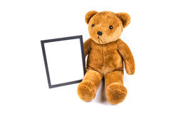 Brown fuzzy teddy bear holding a black frame Stock Photography