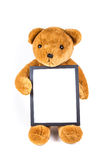 Brown fuzzy teddy bear holding a black frame Royalty Free Stock Photo