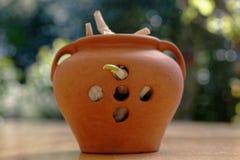 A brown garlic storage pot stock photography