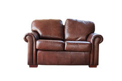 Brown garnissent en cuir le sofa d'isolement sur un fond blanc Photos stock