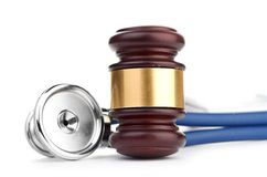 Brown gavel and a medical stethoscope Royalty Free Stock Image