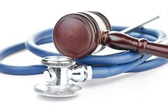 Brown gavel and a medical stethoscope Stock Photography