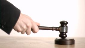 Brown gavel in super slow motion striking a sound block Royalty Free Stock Photo