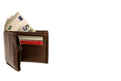 Brown-Geldbörse mit Geld auf weißem Hintergrund lizenzfreies stockbild