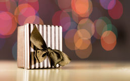 Brown gift box. Brown gift box on bokeh background Stock Photography