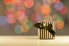 Brown gift box. Brown gift box on bokeh background Stock Photos
