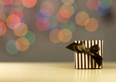 Brown gift box. Brown gift box on bokeh background Stock Images