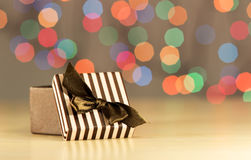 Brown gift box. Brown gift box on bokeh background Stock Photo