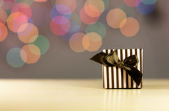 Brown gift box. Brown gift box on bokeh background Royalty Free Stock Photos