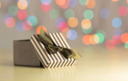 Brown gift box. Brown gift box on bokeh background Royalty Free Stock Photo