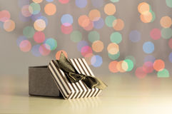 Brown gift box. Brown gift box on bokeh background Royalty Free Stock Photography