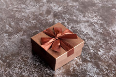 Brown gift box with bow on black table top view Stock Photo