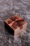 Brown gift box with bow on black table top view Stock Image