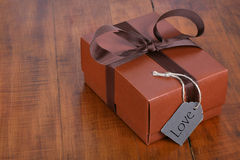 Brown gift box with brown ribbon Royalty Free Stock Photography