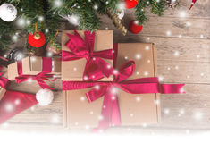 Brown gift box and chirstmas tree. On wooden background Stock Photography