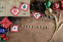 Brown gift box and decoration on old wooden background, Christma Stock Image