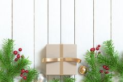 Brown gift box gold ribbon ball tree-leaf christmas background wood floor royalty free stock photography
