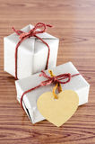 Brown gift box with heart tag card Stock Photography