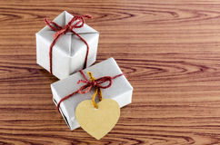 Brown gift box with heart tag card Stock Photo