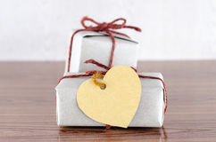 Brown gift box with heart tag card Royalty Free Stock Images