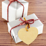 Brown gift box with heart tag card Royalty Free Stock Image