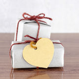 Brown gift box with heart tag card Royalty Free Stock Photo
