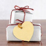 Brown gift box with heart tag card Royalty Free Stock Photography