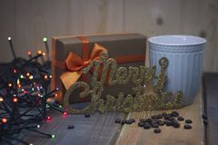 Brown gift box, inscription Marry Christmas blue cup Stock Photos