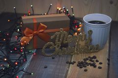 Brown gift box, inscription Marry Christmas blue cup of coffeenn Stock Images