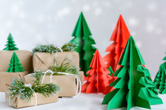 brown gift box and red pine wood paper on a white wooden table Stock Photo