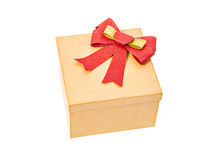 Brown gift box with red ribbon. Royalty Free Stock Photo